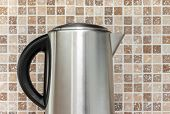 Electric Kettle On Kitchen Tile Background