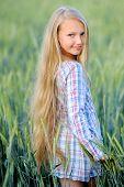 Portrait Of Little Girl Outdoors In Summer