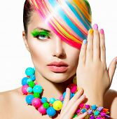 Beauty Girl Portrait with Colorful Makeup, Hair, Nail polish and Accessories. Colourful Studio Shot of Stylish Woman. Vivid Colors. Manicure and Hairstyle. Rainbow Colors
