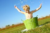Child Splashing Water And Bubbles In Wash Tub
