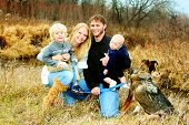 Happy Family In The Woods In Autumn