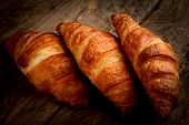 stock photo of french pastry  - croissants for italian breakfast on wooden table - JPG