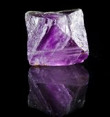 Fluorite Crystal Purple with reflection on black surface background