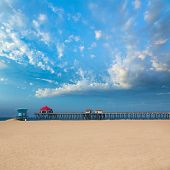 Huntington beach Pier Surf City USA with lifeguard tower in California