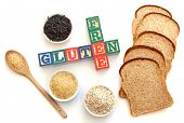 image of wheat-free  - Letter blocks surrounded with gluten free products including wild rice and oats - JPG