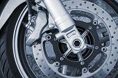 Motorcycle Wheel With Brake. Closeup Monochrome Photo