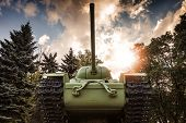 Soviet Heavy Kv-85 Tank From The Second World War With Forest And Dramatic Sky On A Background. Monu