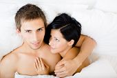Close up view of couple lying in bedroom, top view. Concept of love and affection