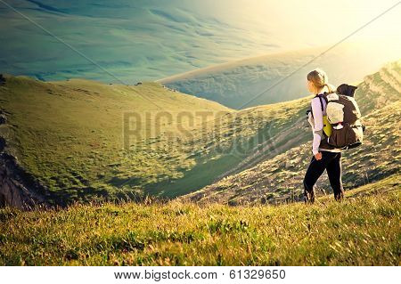 Woman Traveler With Backpack Hiking In Mountains With Beautiful Summer Landscape On Background Mount poster