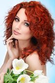 beautiful young redheaded girl with white tulips