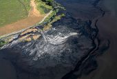 Stream pollution. Aerial view.