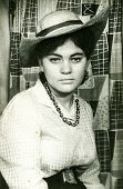 LODZ, POLAND - CIRCA 1960's: Vintage portrait of woman in a hat with a brim