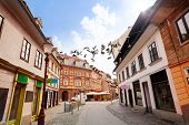 stock photo of yugoslavia  - Trubarjeva street in Ljubljana capital city with sneakers hanging on a telephone line urban youth joke - JPG