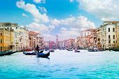 stock photo of gondolier  - Panorama of grand canal with boats gondolas and gondoliers on sunny summer day in Venice Italy - JPG