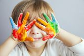 little girl and boy hands painted  in colorful paints