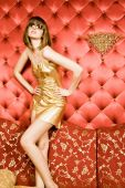 Sexy Young Woman In Golden Dress And Glasses