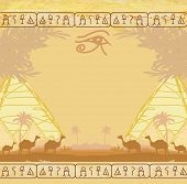 stock photo of horus  - Traditional Horus Eye and camel caravan in wild africa landscape  - JPG