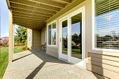 stock photo of concrete  - Backyard walkout deck with concrete floor - JPG