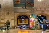 MILAN, ITALY - JUNE 07, 2012: Main timetable and interior of Milan Central Station. Station was open