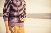 Young Man With Retro Photo Camera Outdoor Hipster Lifestyle With Nature On Background