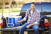 stock photo of pick up  - Man Sitting In Pick Up Truck On Camping Holiday - JPG