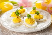 stock photo of yolk  - Deviled eggs with paprika for Easter - JPG