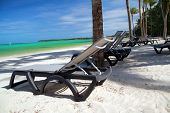 Chaise-longues On Tropical Beach