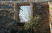 HEVER CASTLE AND GARDENS, KENT, UK - MARCH 10, 2014: Stone wall in park and window