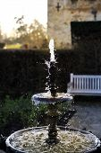 HEVER CASTLE AND GARDENS, KENT, UK - MARCH 10, 2014: Fountain  in 250 acre park. 13th century  Tudor