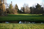 HEVER CASTLE AND GARDENS, KENT, UK - MARCH 10, 2014: River in 250 acre park. 13th century  Tudor man
