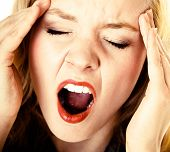 image of scream  - Business woman with head pain screaming - JPG