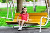 Pretty Little Girl On Swing Bench