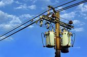 stock photo of transformer  - Transformer and power lines on electric pole - JPG