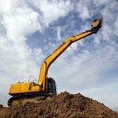 stock photo of backhoe  - the excavator and backhoe on sky background - JPG