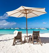 Sun umbrella with chair longue on beach