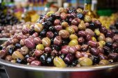 Selection Of Olives In A Bowl For Sale At A Market