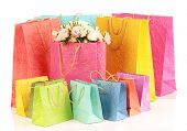 Colorful shopping bags and flowers, isolated on white