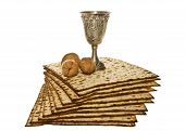 stock photo of passover  - Passover arrangement with Matzo silver Kiddush cup and three walnuts - JPG