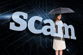 Businesswoman holding umbrella behind the word scam against circuit board