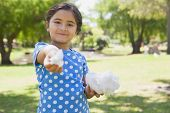 Portrait of a beautiful little girl holding cotton candy at the park