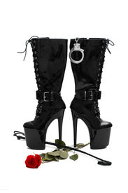 picture of sadism  - Black platform boots with whip and rose isolated on white - JPG