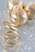 Golden Christmas Balls With Golden Streamer And Snow