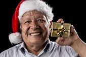Old Gentleman With Red Hat Offering Golden Gift