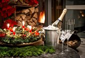 Bottle Of Champagne, Glasses And Fireplace