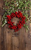 Christmas Tree Branches And Wreath From Red Berries
