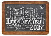 Happy New Year 2015 word cloud - white chalk text  on a vintage slate blackboard isolated on white
