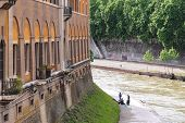 Fishermen On The Bank Of The River Tiber  In Rome, Italy