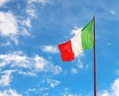 Flag Of Italy Against The Blue Sky