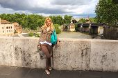 Attractive Girl  On The Bridge Across The Tiber In Rome, Italy