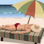 Woman sunbathes on the beach